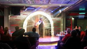 while watching the comedy show at the Cruise's Comedy Bar
